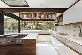 White tile flooring kitchen Large Originally Covered In Colorful Tile The Kitchen Received Monochromatic Upgrade With White Quartz Countertops Dwell Best 60 Modern Kitchen Ceramic Tile Floors Design Photos And Ideas