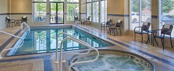a rectangular pool and a round hot tub at the hilton garden inn hotel in mississauga