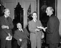 civilization ca history of canadian medicare tommy  photo tommy douglas presents the first hospital card to a pensioner in 1946