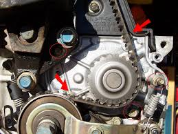 how to replace timing belt timing balancer belt and water pump as you can see 1 of the bolts also has a spring hooked to it for the timing balancer belt tensioner so you ll need either a deep socket or a wrench for