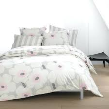 marimeko duvet covers modern tufted bed with sweet white bedding and striped pillows plus beige area