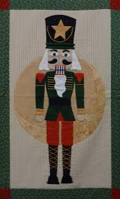 Come Quilt (Sue Garman): Seminars and All Kinds of Quilts & And a nutcracker quilt would not be complete without the classic Nutcracker  Soldier! Nancy did a great job embroidering his uniform. Adamdwight.com