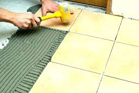 removing ceramic floor tile replacing tiles removing old tile floor adhesive how