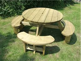 table top a large 1150mm diameter height to seat top 440mm height to table top 750mm timber thickness 38mm throughout material treated softwood