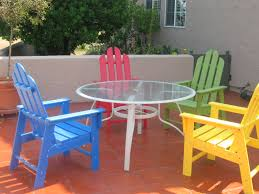 polywood furniture with tile flooring and yellow and blue wooden chair for  exterior decor