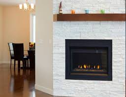 fireplace mantel in white brick wall
