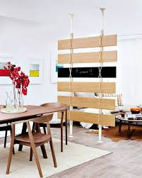 recycling wood floor planks for wall decorations and room dividers