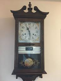 vintage wall clock with pendulum 20th century