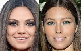 mila kunis with hazel eyes jessica biel with green eyes getty images