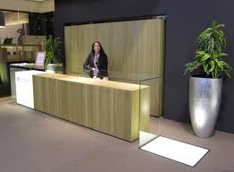 stylish ikea reception desk with potted plant and black wall color for engaging office ideas