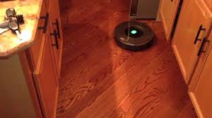 irobot roomba 780 in kitchen with island and hardwood floors hd 720p you
