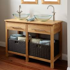 open bathroom vanity cabinet: brown wooden vanity with drawers and shelves having black towel bathroom bowl sinks bathroom floor