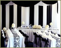 Wedding table decoration with black and white printed runner and bows