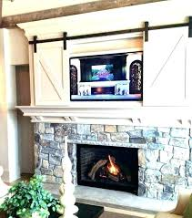 tv above fireplace hiding wires above brick fireplace hide wires