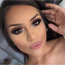 gorgeous glam makeup look with lips a smokey eye and voluminous lashes