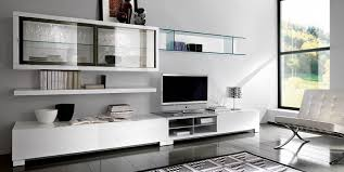 space saving modern living room using custom made tv stands and wall cabinets as storage on calm wall color schemes