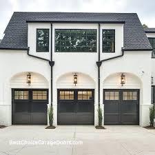 with garage door lighting over each black carriage house and plantings in between repair boise opener