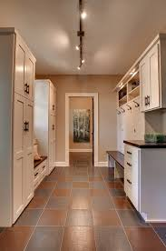 A track light is a smart idea for a mudroom. Photo credit: Traditional  Laundry