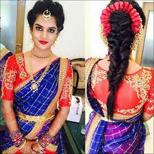 south indian bridal hairstyles for receptions fishtail with flowers