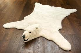 fake animal rug image of polar bear skin rugs with heads