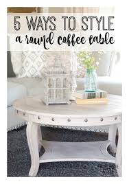 today i m showing you 5 ways to style a round coffee table now for my examples i didn t go out and anything i used what decor i had around the house