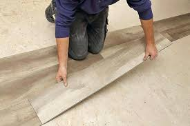 vinyl plank cutting flooring with a saw floors that look like hardwood