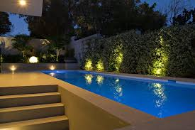 contemporary landscape lighting. color pool light contemporary with shrubs outdoor sofas landscape lighting u