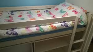 cabin bed in white stained pine including under bed shelves and retractable desk