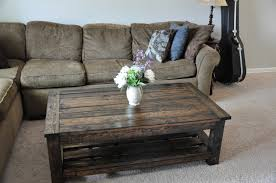 living room with shabby l shaped sofa and distressed diy pallet table