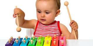 Baby playing with a toy Good Toys for Young Children by Age and Stage   NAEYC
