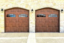 brown garage doors with windows. Dark Brown Garage Doors Village Homes Red Brick And Stained Door Paired With Green Windows A