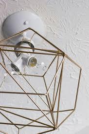 carefully reach inside the geometric figurine to install your light bulbs diy geometric pendant light tutorial