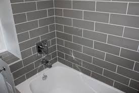 bathroom tile design odolduckdns regard: example of a small minimalist bathroom design in toronto with gray tile and ceramic tile saveemail