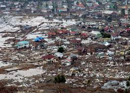 what causes a tsunami writework a destroyed town in sumatra after being hit by a tsunami caused by the 2004