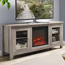 an electric fireplace accents this tv stand lending it visual appeal while clean lines pair with