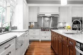 white kitchen cabinets with stainless steel subway tile backsplash