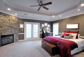 how much does it cost to paint a ceiling by ryanc interior of a large modern bedroom with a fireplace and ceiling fan horizontal format
