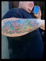 amazing graffiti text tattoo on lower arm