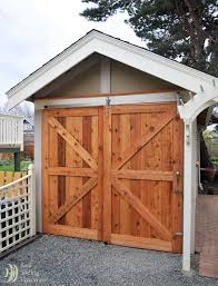 Large barn doors on an outdoor shed (right door slides over fixed door).