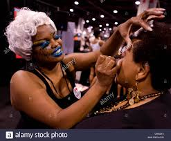 04 2016 atlanta georgia usa a makeup artist works with a convention attendee at the 65th annual bronner brothers international hair show