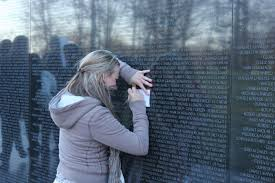 Small Picture Hidden From View Offerings at Vietnam Memorial Reveal Nations