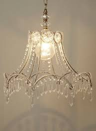 shade chandelier lighting. diy idea old lamp shade skeletons chandelier lighting