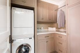 laundry room furniture. Furniture Beige Cabinets With Tile Backsplash And White Counter Laundry Room