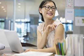 office space pic. businesswoman looking away at office desk space pic