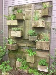 vertical vegetable garden house design with diy wall mounted wood planter box ideas