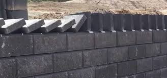 news stone workers play dominoes with bricks to create perfectly aligned wall cap