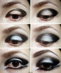gothic makeup tutorial prime your eyelids and start to fill your lids with black pencil
