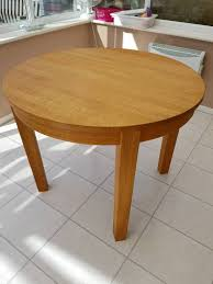solid oak double extending round dining table