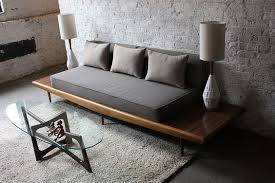 Sofa on the long table has no side handles. This is really giving a best  idea if you're looking for newer sofa design.