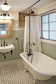 vintage inspired bathroom with a clawfoot tub and black accents to pull everything off